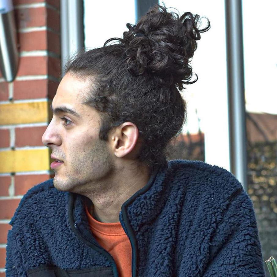Men's Bun + Curl Hair Haircuts For Men